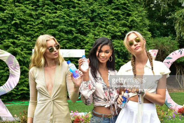 Josephine Skriver Chanel Iman and Elsa Hosk attend the FIJI Water at #REVOLVEintheHamptons 2017 on July 22 2017 in Bridgehampton New York