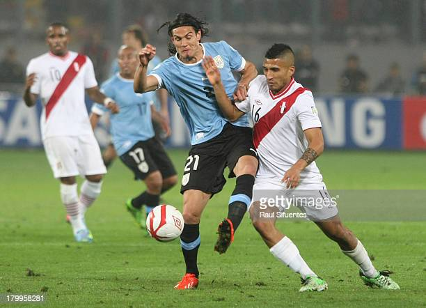 Josepmir Ballon of Peru fights for the ball with Edison Cavani of Uruguay during a match between Peru and Uruguay as part of the 15th round of the...