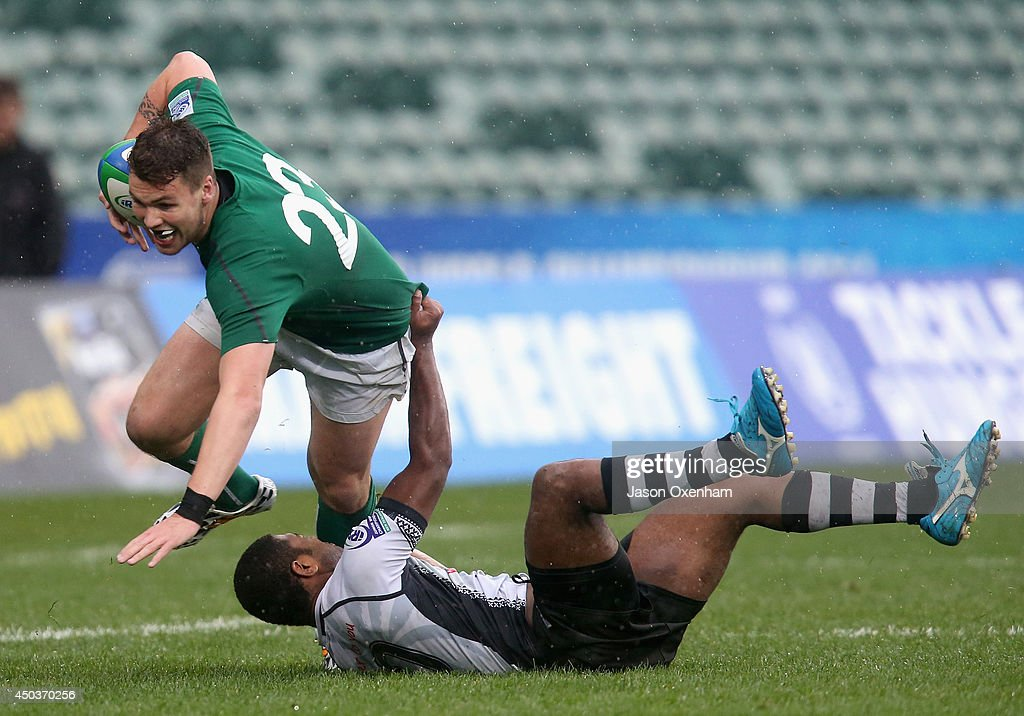 Josese Kurukava of Fiji tries to stop Harrison Brewer of Ireland during the 2014 Junior World Championship match between Fiji and Ireland at QBE Stadium, Albany on June 10, 2014 in Auckland, New Zealand.