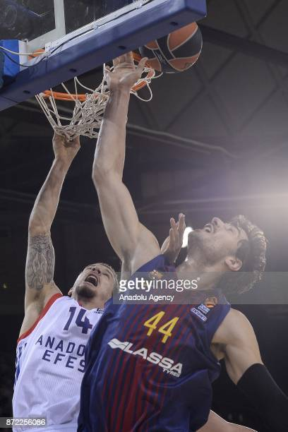 Josh Adams of Anadolu Efes in action against Ante Tomic of Barcelona during the Turkish Airlines Euroleague basketball match between Barcelona and...