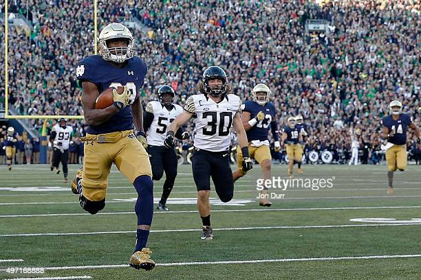 Josh Adams of the Notre Dame Fighting Irish rushes for a 98yard touchdown against the Wake Forest Demon Deacons during the second quarter at Notre...