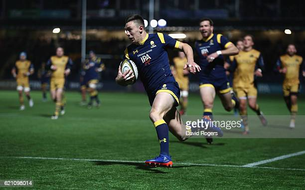 Josh Adams of Worcester breaks with the ball to score the first try during the AngloWelsh Cup match between Worcester Warriors and Bristol at Sixways...