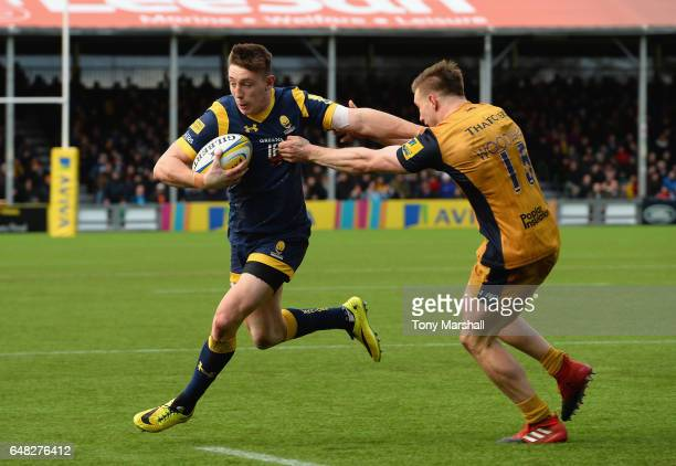Josh Adams of Worcester Warriors is tackled by Jason Woodward of Bristol Rugby during the Aviva Premiership match between Worcester Warriors and...
