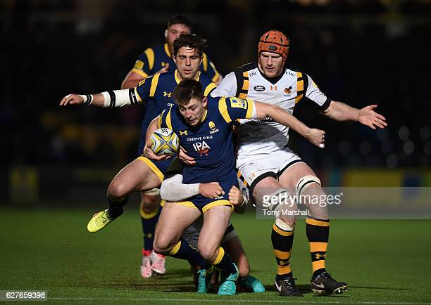 Josh Adams of Worcester Warriors is tackled by Rob Miller and Kearnan Myall of Wasps during the Aviva Premiership match between Worcester Warriors...