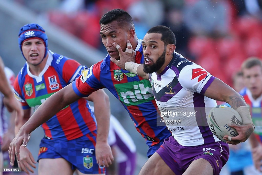Josh Addo-Carr of the Storm is tackled by Jacob Saifiti of the Knights during the round 24 NRL match between the Newcastle Knights and the Melbourne Storm at McDonald Jones Stadium on August 19, 2017 in Newcastle, Australia.