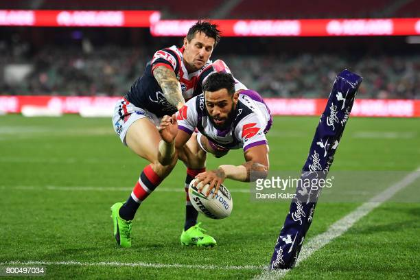 Josh AddoCarr of the Storm scores a try during the round 16 NRL match between the Sydney Roosters and the Melbourne Storm at Adelaide Oval on June 24...