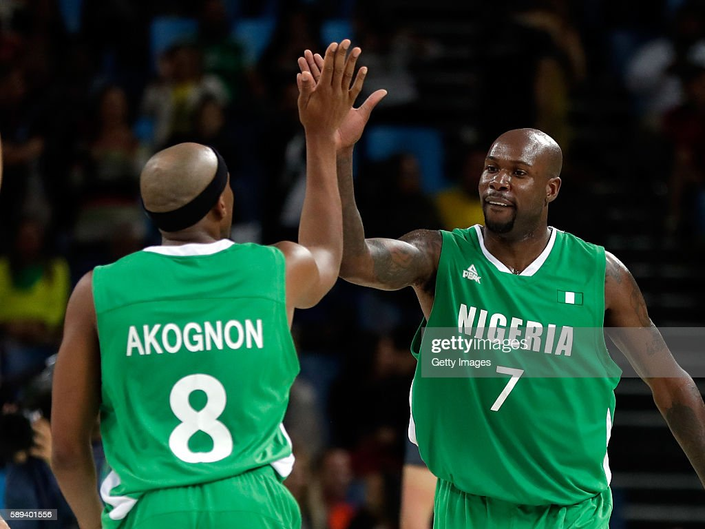 Josh Akognon and AlFarouq Aminu of Nigeria cogratulate each other after Nigeria defeated Croatia 9076 to win the preliminary round game at the Rio...