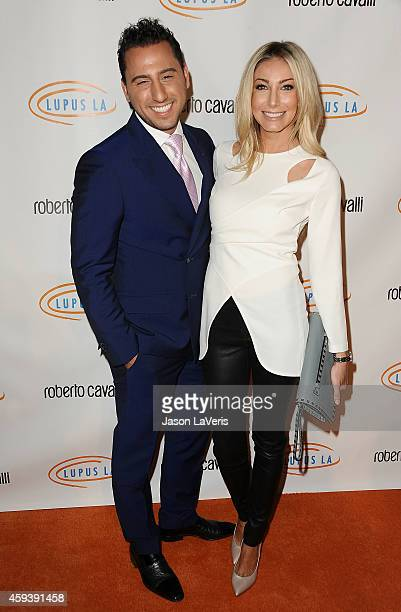 Josh Altman and Heather Bilyeu attend the 12th annual Lupus LA Hollywood Bag Ladies luncheon at The Beverly Hilton Hotel on November 21 2014 in...