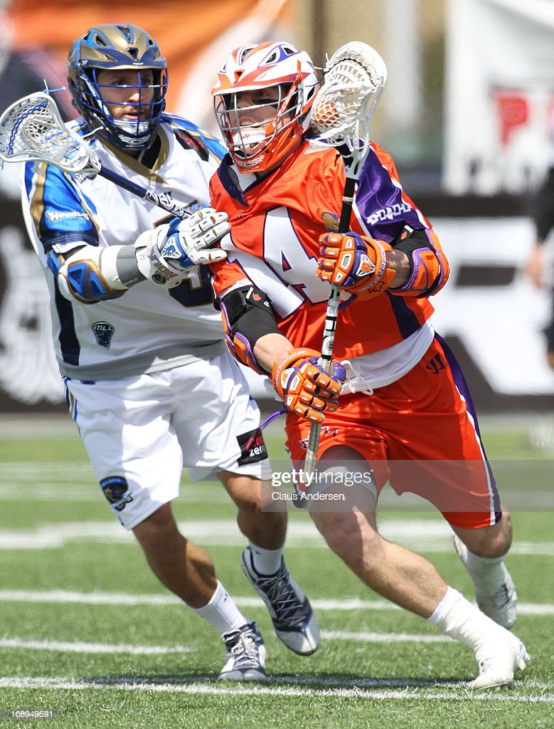 Josh Amidon #9 of the Charlotte Hounds checks Cameron Lao-Gosney #14 of the Hamilton Nationals in a Major League Lacrosse game on May 17, 2013 at Ron Joyce Stadium in Hamilton, Ontario, Canada.