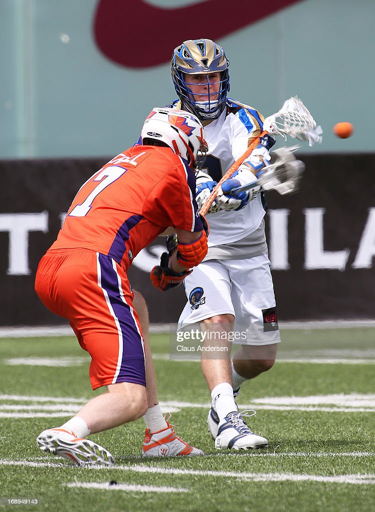 Josh Amidon #9 of the Charlotte Hounds fires a shot against the Hamilton Nationals in a Major League Lacrosse game at Ron Joyce Stadium in Hamilton, Ontario, Canada. The Nationals defeated the Hounds 16-15 in overtime.
