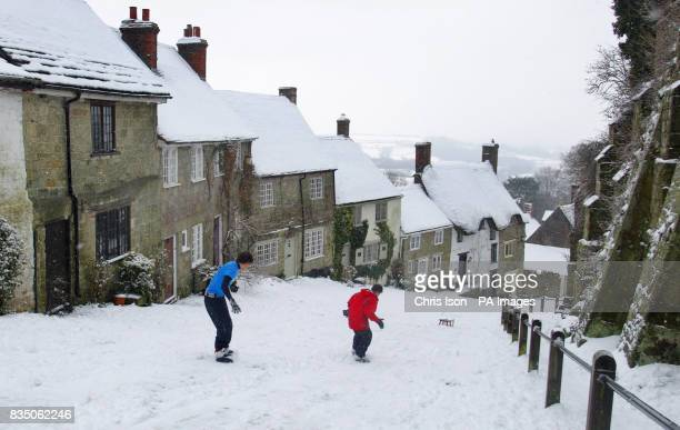 Josh and his brother Danny Wyman snowboard down the iconic Gold Hill in Shaftesbury Dorset where it has snowed everyday this week