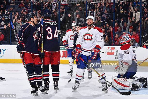 Josh Anderson of the Columbus Blue Jackets celebrates his third period goal with teammate Jack Johnson of the Columbus Blue Jackets during a game...