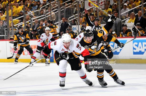 Josh Archibald of the Pittsburgh Penguins and Dion Phaneuf of the Ottawa Senators battle in Game Five of the Eastern Conference Final during the 2017...