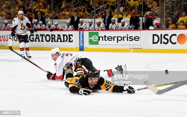 Josh Archibald of the Pittsburgh Penguins is tripped by Dion Phaneuf of the Ottawa Senators in Game Five of the Eastern Conference Final during the...