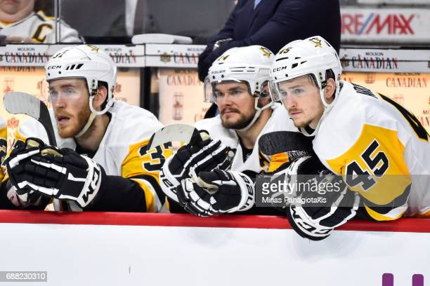Josh Archibald of the Pittsburgh Penguins leans over the boards as he sits on the bench against the Ottawa Senators in Game Six of the Eastern...