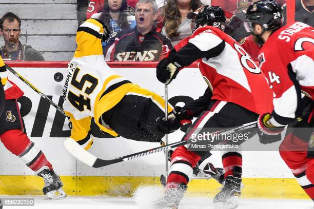 Josh Archibald of the Pittsburgh Penguins loses his balance as he chases the puck against the Ottawa Senators in Game Six of the Eastern Conference...