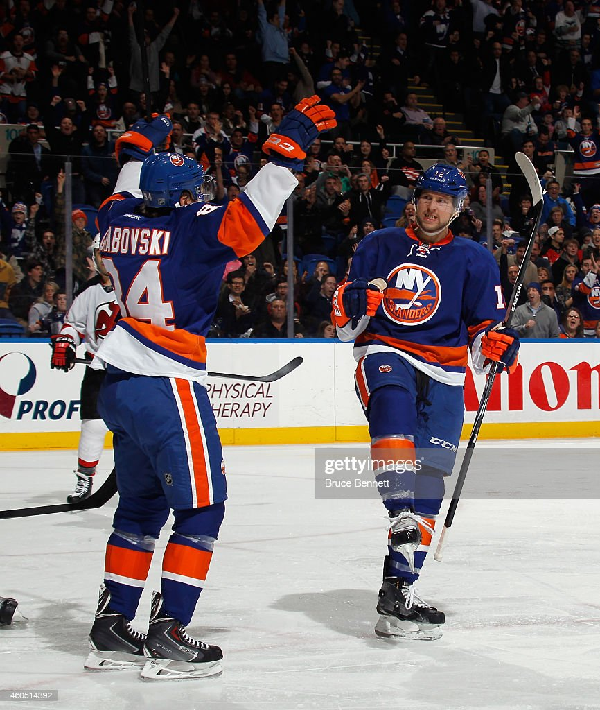 51 of the second period against the New Jersey Devils and is joined by <a gi-track='captionPersonalityLinkClicked' href=/galleries/search?phrase=Mikhail+Grabovski&family=editorial&specificpeople=2560547 ng-click='$event.stopPropagation()'>Mikhail Grabovski</a> #84 at the Nassau Veterans Memorial Coliseum on December 15, 2014 in Uniondale, New York.