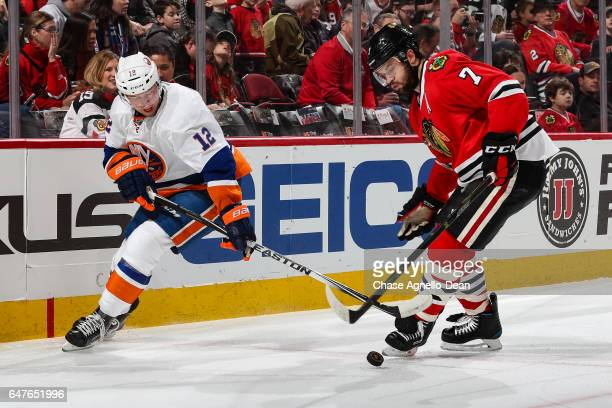 Josh Bailey of the New York Islanders and Brent Seabrook of the Chicago Blackhawks battle for the puck in the first period at the United Center on...