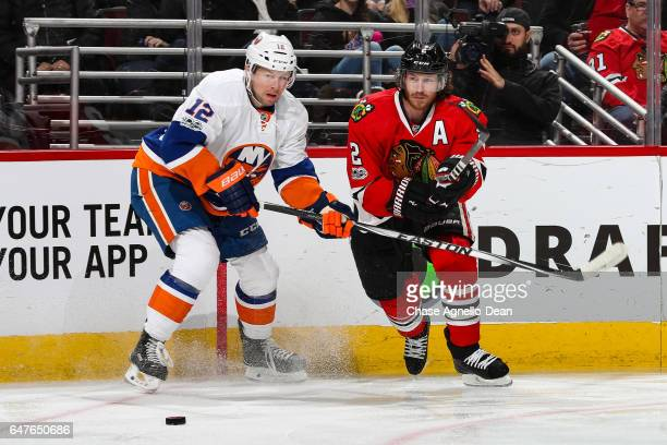 Josh Bailey of the New York Islanders and Duncan Keith of the Chicago Blackhawks chase the puck in the first period at the United Center on March 3...