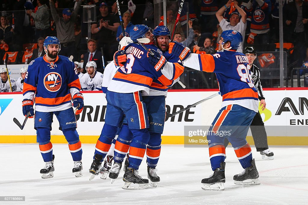 Josh Bailey #12 of the New York Islanders celebrates his first period goal with <a gi-track='captionPersonalityLinkClicked' href=/galleries/search?phrase=Nick+Leddy&family=editorial&specificpeople=5894600 ng-click='$event.stopPropagation()'>Nick Leddy</a> #2, <a gi-track='captionPersonalityLinkClicked' href=/galleries/search?phrase=Travis+Hamonic&family=editorial&specificpeople=4605791 ng-click='$event.stopPropagation()'>Travis Hamonic</a> #3, and Nikolay Kulemin #86 against the Tampa Bay Lightning in Game Three of the Eastern Conference Second Round during the NHL 2016 Stanley Cup Playoffs at the Barclays Center on May 3, 2016 in Brooklyn borough of New York City.