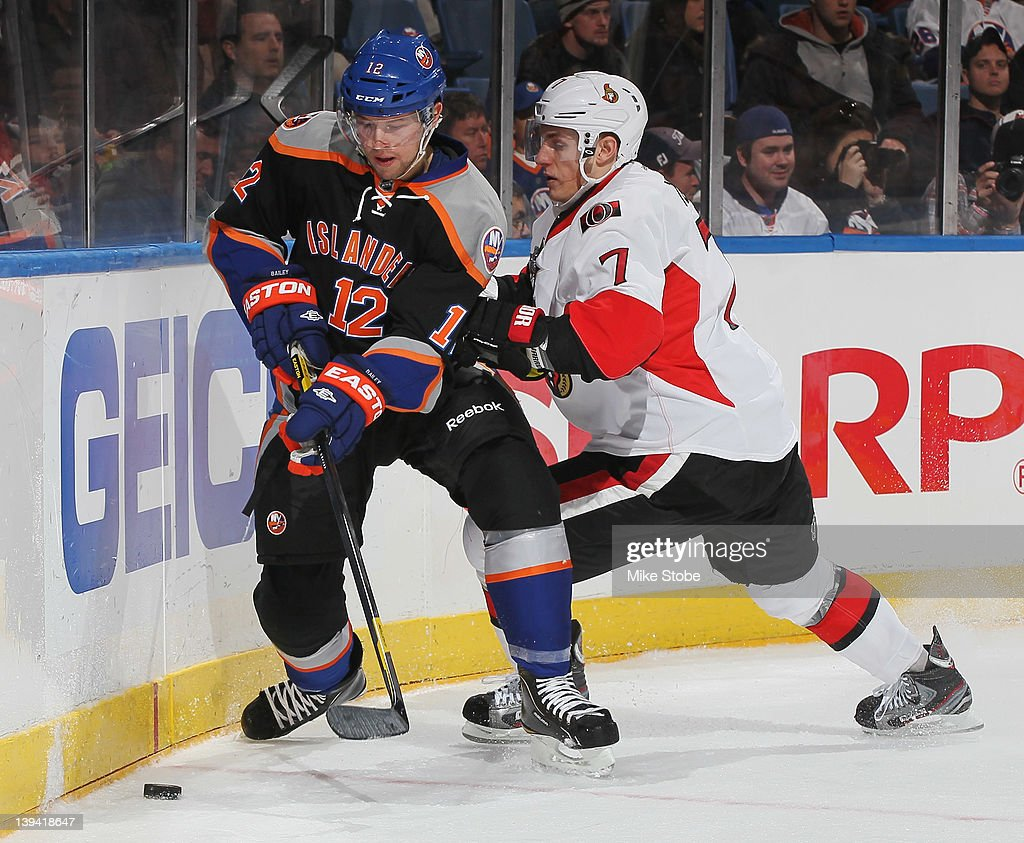 <a gi-track='captionPersonalityLinkClicked' href=/galleries/search?phrase=Josh+Bailey+-+Ice+Hockey+Player&family=editorial&specificpeople=3321456 ng-click='$event.stopPropagation()'>Josh Bailey</a> #12 of the New York Islanders is checked by <a gi-track='captionPersonalityLinkClicked' href=/galleries/search?phrase=Kyle+Turris&family=editorial&specificpeople=4251834 ng-click='$event.stopPropagation()'>Kyle Turris</a> #7 of the Ottawa Senators at Nassau Veterans Memorial Coliseum on February 20, 2012 in Uniondale, New York. The Senators defeated the Islanders 6-0.