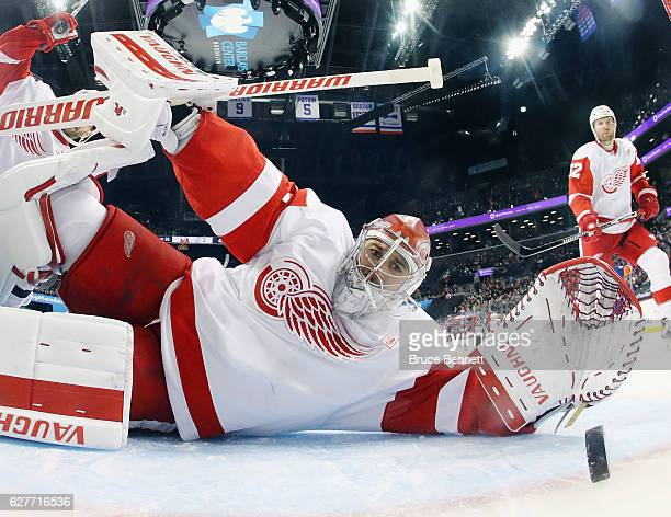 Josh Bailey of the New York Islanders scores at 1539 of the third period against Petr Mrazek of the Detroit Red Wings at the Barclays Center on...