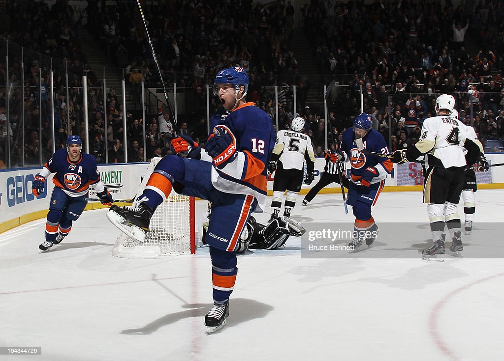 <a gi-track='captionPersonalityLinkClicked' href=/galleries/search?phrase=Josh+Bailey&family=editorial&specificpeople=3321456 ng-click='$event.stopPropagation()'>Josh Bailey</a> #12 of the New York Islanders scores at 17:18 of the second period against the Pittsburgh Penguins at Nassau Veterans Memorial Coliseum on March 22, 2013 in Uniondale, New York.