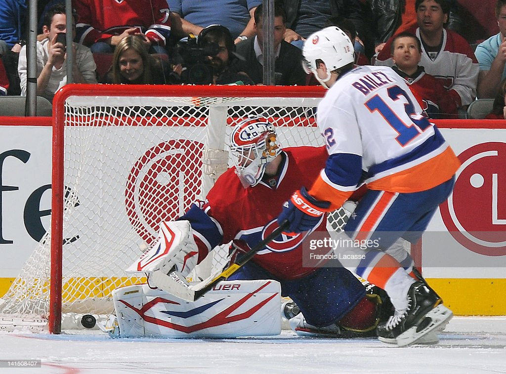 <a gi-track='captionPersonalityLinkClicked' href=/galleries/search?phrase=Josh+Bailey+-+Ice+Hockey+Player&family=editorial&specificpeople=3321456 ng-click='$event.stopPropagation()'>Josh Bailey</a> #12 of the New York Islanders scores the game winning goal during a shoot out against <a gi-track='captionPersonalityLinkClicked' href=/galleries/search?phrase=Peter+Budaj&family=editorial&specificpeople=228123 ng-click='$event.stopPropagation()'>Peter Budaj</a> #30 the Montreal Canadiens on March 17, 2012 at the Bell Centre in Montreal, Quebec, Canada.