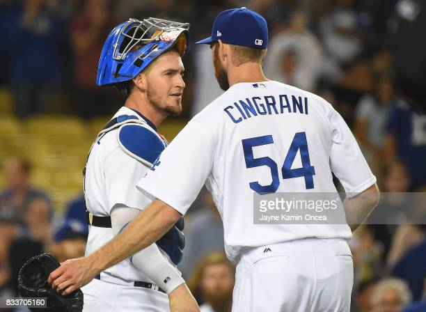 Josh Bard of the Los Angeles Dodgers is greeted by Yasmani Grandal after earning a save in the ninth inning of the game against the Chicago White Sox...