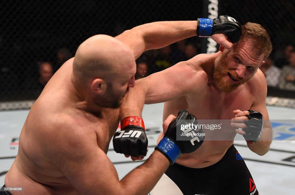 Josh Barnett punches Ben Rothwell in their heavyweight bout during the UFC Fight Night event at the Prudential Center on January 30, 2016 in Newark, New Jersey.