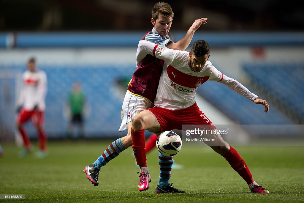 Josh Barton of Aston Villa U19 is challenged by Charalampos Lykogiannis of Olympiacos U19 during the NextGenSeries Quarter Final match at Villa Park on March 20, 2013 in Birmingham, England.