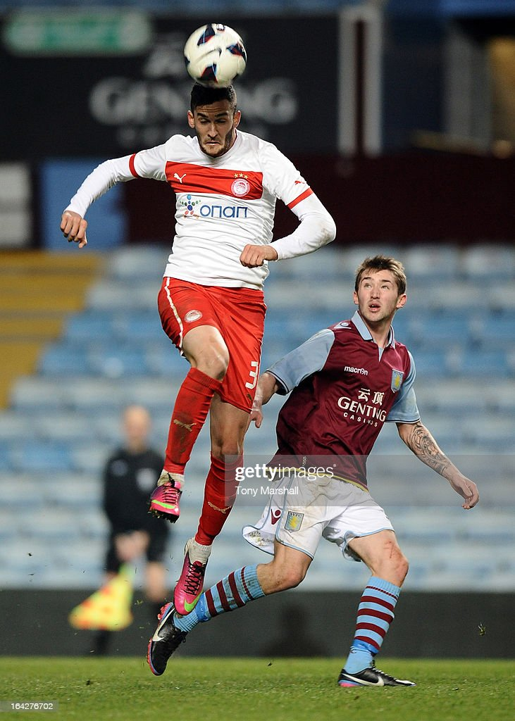 Josh Barton (R) of Aston Villa watches Charalampos Lykogiannis of Olympiacos during the NextGen Series Quarter Final match between Aston Villa U19 and Olympiacos U19 at Villa Park on March 20, 2013 in Birmingham, England.
