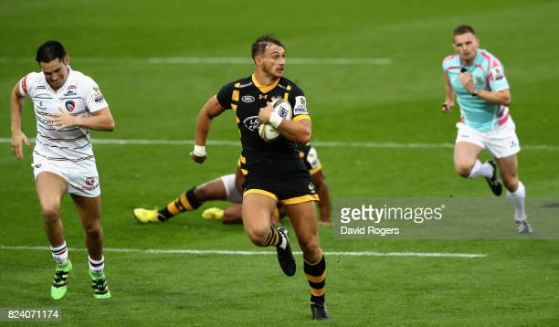 Josh Bassett of Wasps breaks clear to score a try in the match against Leicester Tigers during the Singha Premiership Rugby 7s Series Day One at...