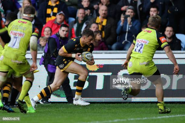 Josh Bassett of Wasps breaks clear to score the last minute match winning try during the Aviva Premiership semi final match between Wasps and...