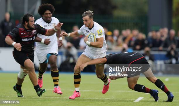 Josh Bassett of Wasps breaks with the ball during the Aviva Premiership match between Saracens and Wasps at Allianz Park on October 8 2017 in Barnet...
