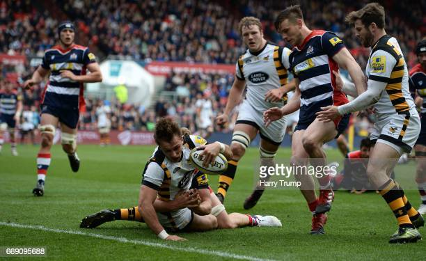 Josh Bassett of Wasps goes over for his side's first try during the Aviva Premiership match between Bristol Rugby and Wasps at Ashton Gate on April...