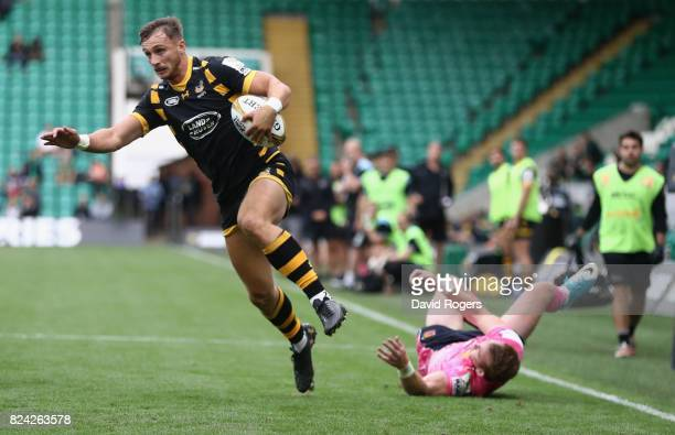 Josh Bassett of Wasps scores a try against Exeter Chiefs during the Singha Premiership Rugby 7s Series Day Two at Franklin's Gardens on July 29 2017...