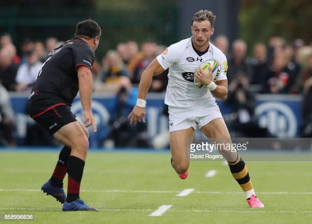Josh Bassett of Wasps takes on Jamie George during the Aviva Premiership match between Saracens and Wasps at Allianz Park on October 8 2017 in Barnet...
