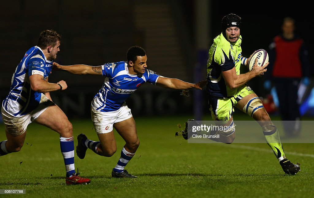 Josh Beaumont of Sale Sharks attempts to move forward with the ball away from Ashton Hewitt and Elliot Dee of the Newport Gwent Dragons during the...