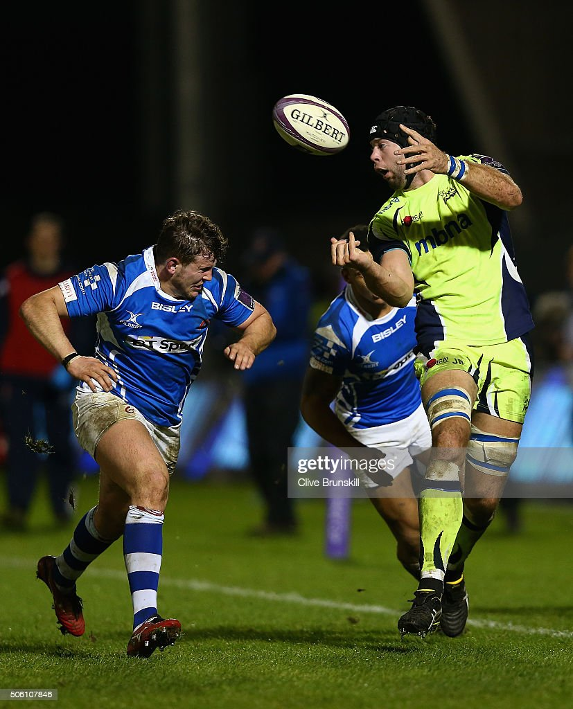 Josh Beaumont of Sale Sharks attempts to pass the ball away from Ashton Hewitt and Elliot Dee of the Newport Gwent Dragons during the European Rugby...