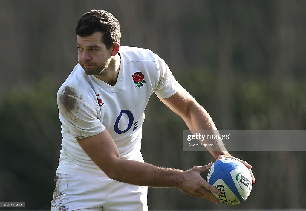 Josh Beaumont passes the ball during the England training session held at Pennyhill Park on February 12, 2016 in Bagshot, England.