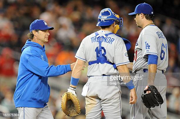 Josh Beckett of the Los Angeles Dodgers is removed from the game by manager Don Mattingly in the eighth inning against the Washington Nationals at...