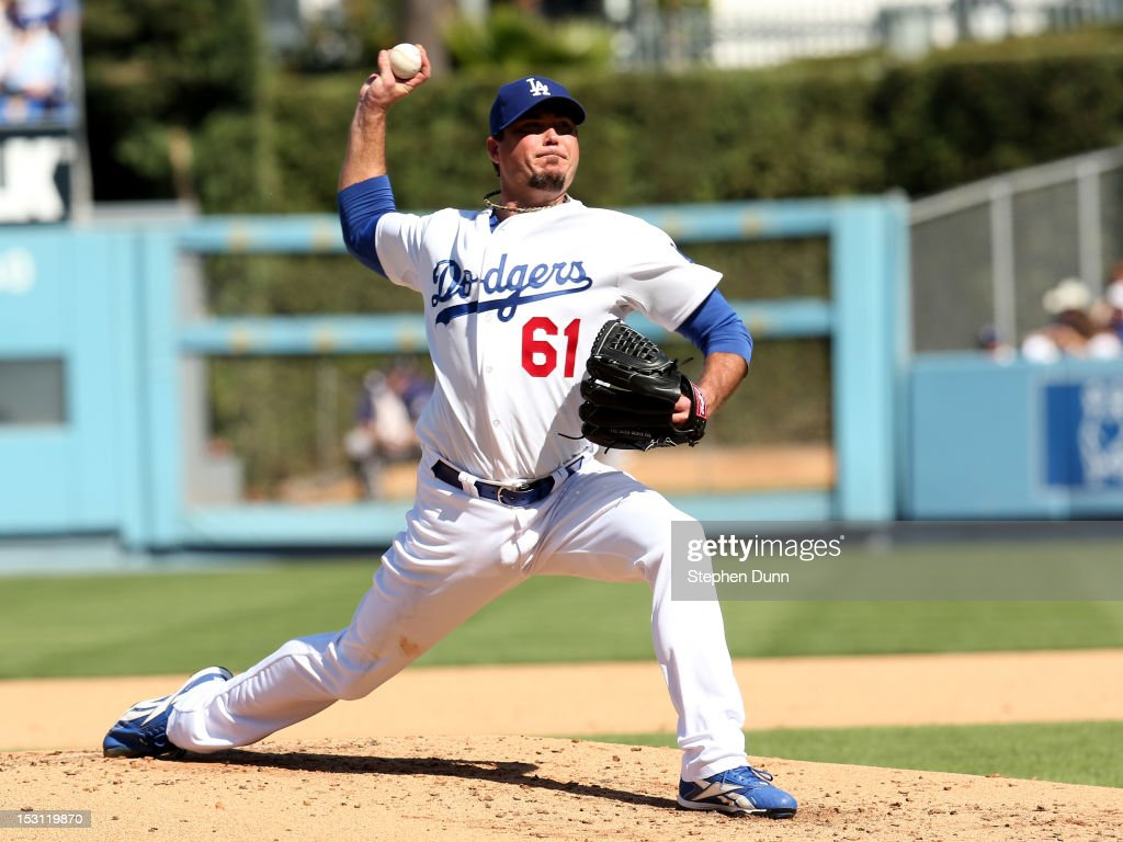 <a gi-track='captionPersonalityLinkClicked' href=/galleries/search?phrase=Josh+Beckett&family=editorial&specificpeople=206314 ng-click='$event.stopPropagation()'>Josh Beckett</a> #61 of the Los Angeles Dodgers throws a pitch against the Colorado Rockies on September 30, 2012 at Dodger Stadium in Los Angeles, California.