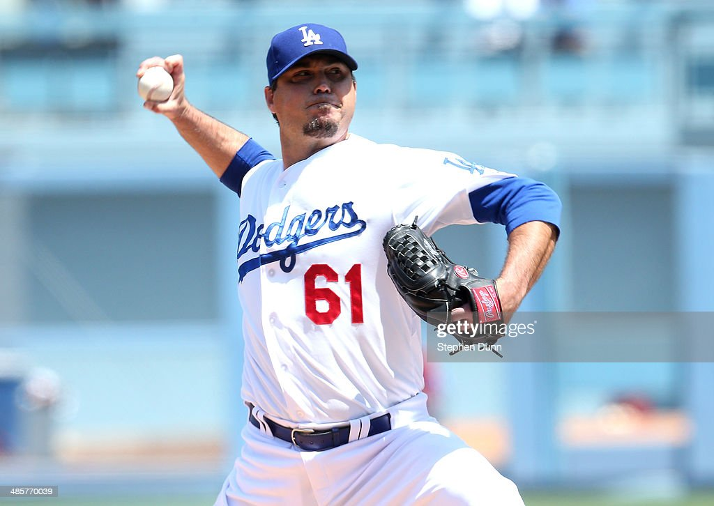 <a gi-track='captionPersonalityLinkClicked' href=/galleries/search?phrase=Josh+Beckett&family=editorial&specificpeople=206314 ng-click='$event.stopPropagation()'>Josh Beckett</a> #61 of the Los Angeles Dodgers throws a pitch against the Arizona Diamondbacks at Dodger Stadium on April 20, 2014 in Los Angeles, California.
