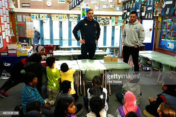Josh Bekhuis of Southland and Carl Axtons of Bay of Plenty deliver milk to school children at New Windsor School before the 2015 ITM Cup season...
