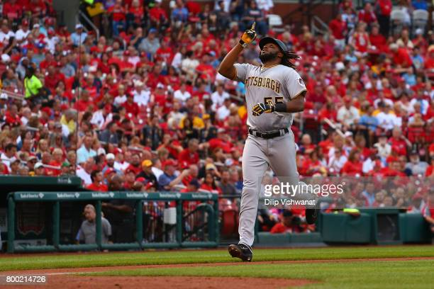 Josh Bell of the Pittsburgh Pirates celebrates after hitting a solo home run against the St Louis Cardinals in the second inning at Busch Stadium on...