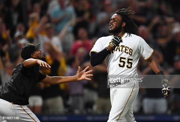 Josh Bell of the Pittsburgh Pirates celebrates his three run home run during the ninth inning against the St Louis Cardinals at PNC Park on July 14...