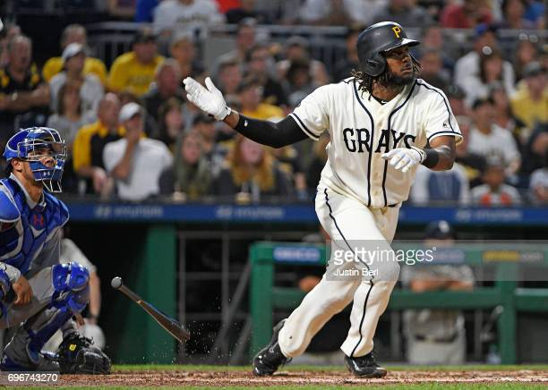 Josh Bell of the Pittsburgh Pirates hits a 2 run RBI triple to right field in the sixth inning during the game against the Chicago Cubs at PNC Park...
