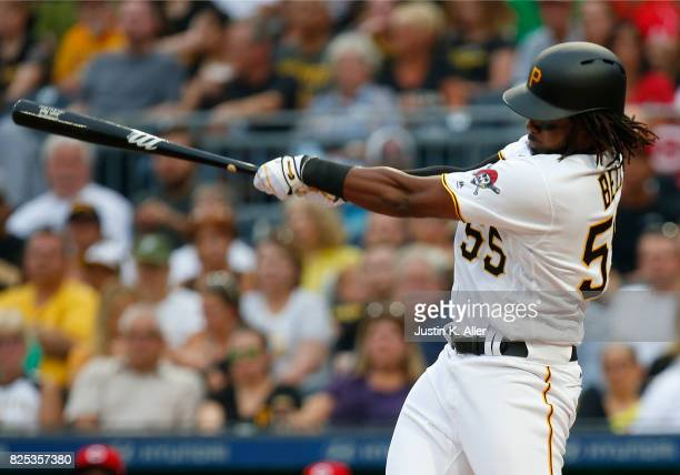 Josh Bell of the Pittsburgh Pirates hits a RBI single in the first inning against the Cincinnati Reds at PNC Park on August 1 2017 in Pittsburgh...