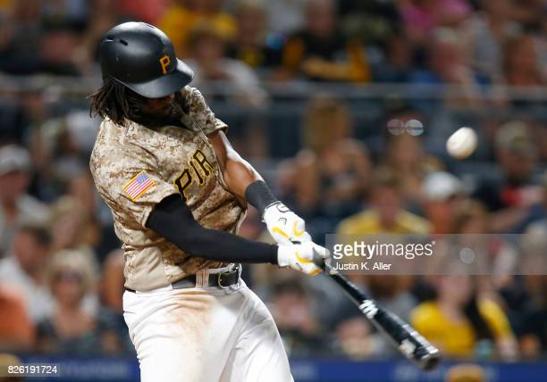 Josh Bell of the Pittsburgh Pirates hits a sacrifice fly in the seventh inning against the Cincinnati Reds at PNC Park on August 3 2017 in Pittsburgh...